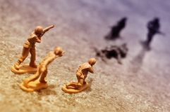 Toy soldiers fighting stock photos