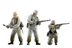 Toy Soldiers. German military soldier in WWII Snow suit miniature model Royalty Free Stock Photo