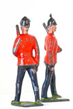 Toy soldiers - Marching guards with rifles. Vintage toy soldiers marching at different angles Royalty Free Stock Image