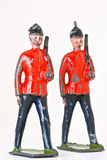 Toy soldiers - Marching guards with rifles. Vintage toy marching guards at different angles Stock Image