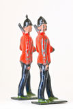 Toy soldiers - Marching sideway. Vintage toy marching guards at sideway angle Royalty Free Stock Photography