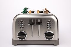 Toy soldiers playing in toaster Stock Image