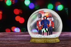 Toy soldiers. In snow globe royalty free illustration