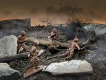 Toy soldiers war scene. Plastic brown toy soldiers war scene attack Stock Image