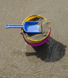Toy Spade and Bucket on a Beach Stock Photography