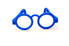 Toy spectacles. A pair of blue plastic toy doctor spectacles for kids to play with. Image isolated on white studio background Stock Images
