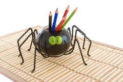 Toy spider with a pencils. Royalty Free Stock Images