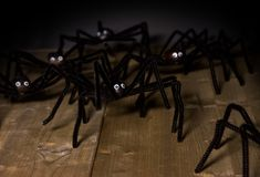 Toy spiders attack. Funny toy spiders made of chestnuts and furry wire attack on Halloween Royalty Free Stock Photography