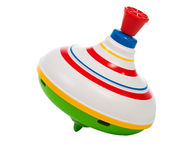 Toy spinning top. Isolated on a white background stock images