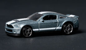 Toy sport car. On a black background Royalty Free Stock Photo