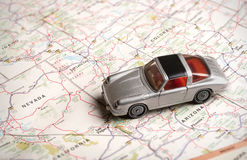 Toy sports car on a road map. Toy Porsche sports car on a road map near Las Vegas Nevada Royalty Free Stock Photo