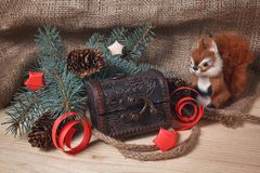 Toy squirrel and chest under the Christmas tree. Gift Stock Photo