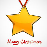 Toy star hanging on red ribbon. Stock Photo