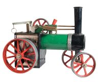 Toy Steam Engine. Old toy steam engine in the shape of a steam threshing tractor Stock Images