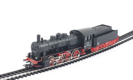 Toy steam locomotive on white. Background Stock Photo