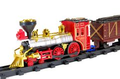 Toy Steam Train and freight wagon. Toy Steam Train and and freight wagon on white background Royalty Free Stock Photo