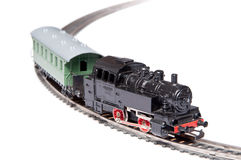 Toy steam train pulling one carriage Royalty Free Stock Photos
