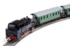 Toy steam train pusing two carriages Stock Images