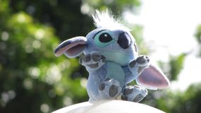 Toy Stitch. With trees behind royalty free stock photography