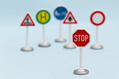 Toy Stop Street Signs. Toy Street Warning Signs with Stop Sign in Foreground Royalty Free Stock Image