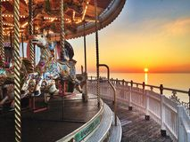 Toy story. Beautiful sunset in Brighton with horse carousel on front view Stock Photography
