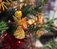 Toy straw angel on the Christmas tree branch Royalty Free Stock Images