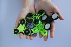 Toy stress Fidget spinner hand Stock Photos