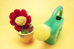 Toy Sunflower and Watering Can Royalty Free Stock Images
