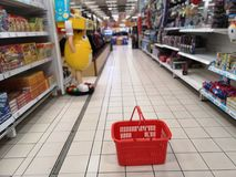 Toy in the supermarket and empty shopping cart royalty free stock images