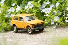 Toy Suv on Country Road Royalty Free Stock Images