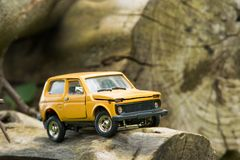 Toy SUV on Logs Stock Photo