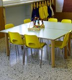 Toy on the table in the daycare center. And small yellow chairs Royalty Free Stock Photos