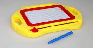 Toy Tablet di plastica con la penna fotografia stock libera da diritti