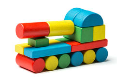 Toy tank, multicolor wooden blocks, military transport over whit Royalty Free Stock Photography