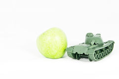 Toy Tank protect Green Apple Royalty Free Stock Images