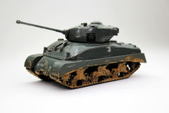 Toy tank. A toy tank on a white background Royalty Free Stock Photo