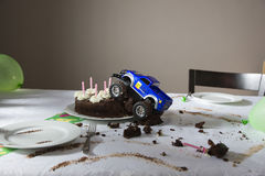 Toy Tar Driven Into Birthday-Cake Stock Fotografie