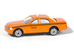 Toy Taxi Cab. Orange Toy Taxi Cab Isolated on White Background Royalty Free Stock Photos