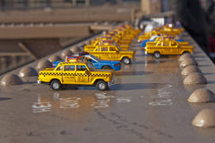 Toy Taxis on Brooklyn Bridge Beam Stock Photo