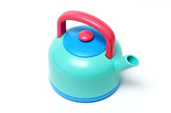 Toy tea-pot. Plastic toy tea-pot isolated over white background macro shot Stock Photos