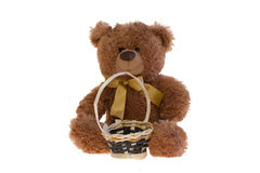 Toy teddy bear with a basket. Taken an over white. Isolated Stock Images