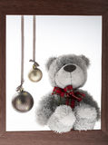 Toy teddy bear with blank board, on wooden background Stock Image