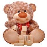 Toy teddy bear building tower Stock Photos
