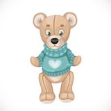 Toy teddy bear in a green sweater Stock Images