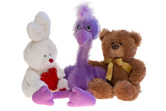 Toy teddy bear, ostrich and rabbit together. Taken an over white Stock Photos