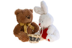 Toy teddy bear and a rabbit with a basket. Taken an over white Royalty Free Stock Photo