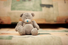 Toy teddy bear sits on the couch Stock Photography