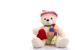 Toy teddy bear sitting with valentine heart Stock Photos