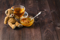 Toy teddy bear on table with honey Stock Photos