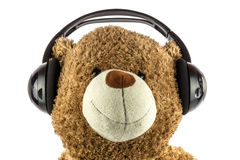 Toy Teddy Bear Using Headphones Royalty Free Stock Photo